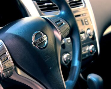 The steering wheel of a Nissan car