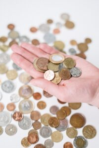 Holding Euro coins
