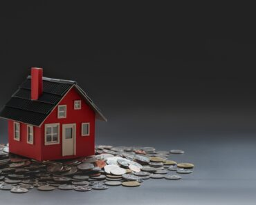 A toy house and a pile of money