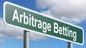 A signpost saying arbitrage betting