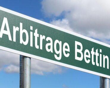 A signpost saying arbitrage betting