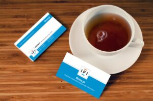 Business cards and a cup of coffee