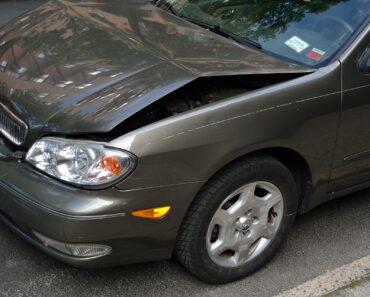A car with a damaged bonnet after a crash