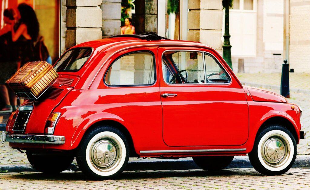 A red Fiat 500 car