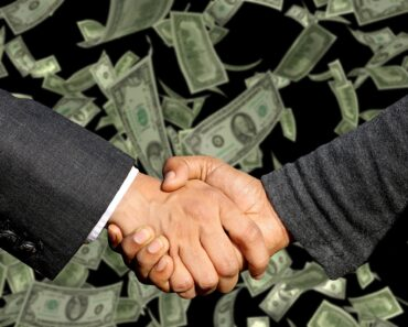 Shaking hands on a financial agreement