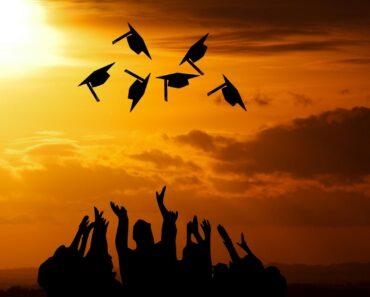 College graduation at sunset