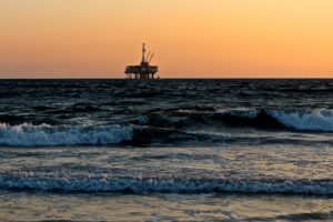An oil rig from the shore