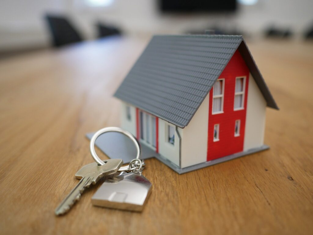 A toy house and a door key