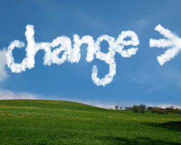 "The word ""Change"" written in clouds"