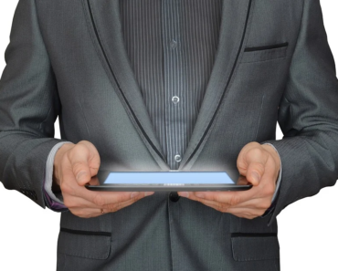 A businessman using his tablet computer