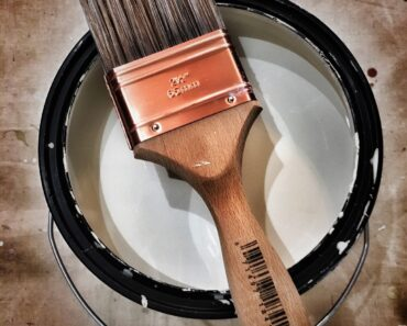 A tin of paint and a brush