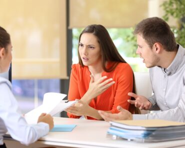 A separation lawyer consulting with a couple