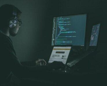 A computer hacker in a darkened room
