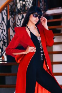 A model wearing a red coat