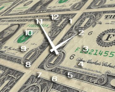 Money with a clock face superimposed on it.