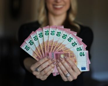 A woman displaying money