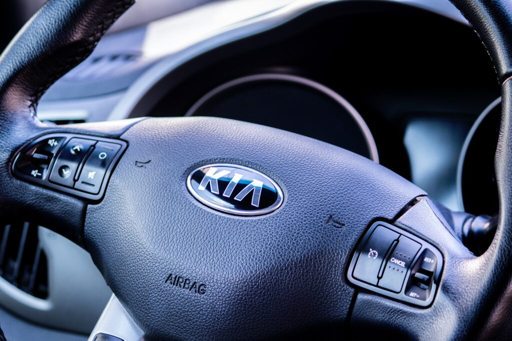 A steering wheel of a Kia car