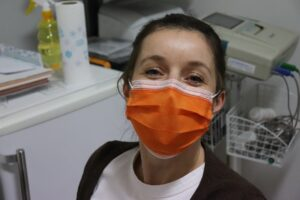 A nurse wearing a surgical mask