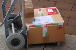 Heavy parcels being delivered