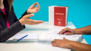 A human resource manager checks employment law