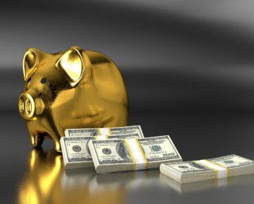 A golden piggy bank and money