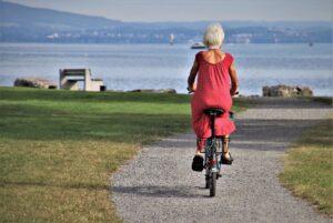 A senior lady riding a bike