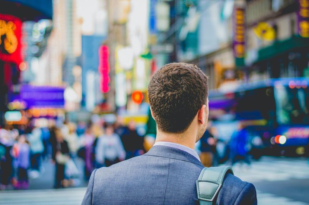 A businessman walking in a city