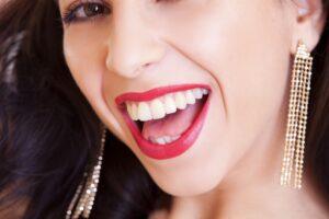 A happy girl wearing large earrings