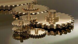 Golden interlocking cog wheels