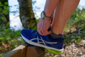 Tying up the laces of a running shoe