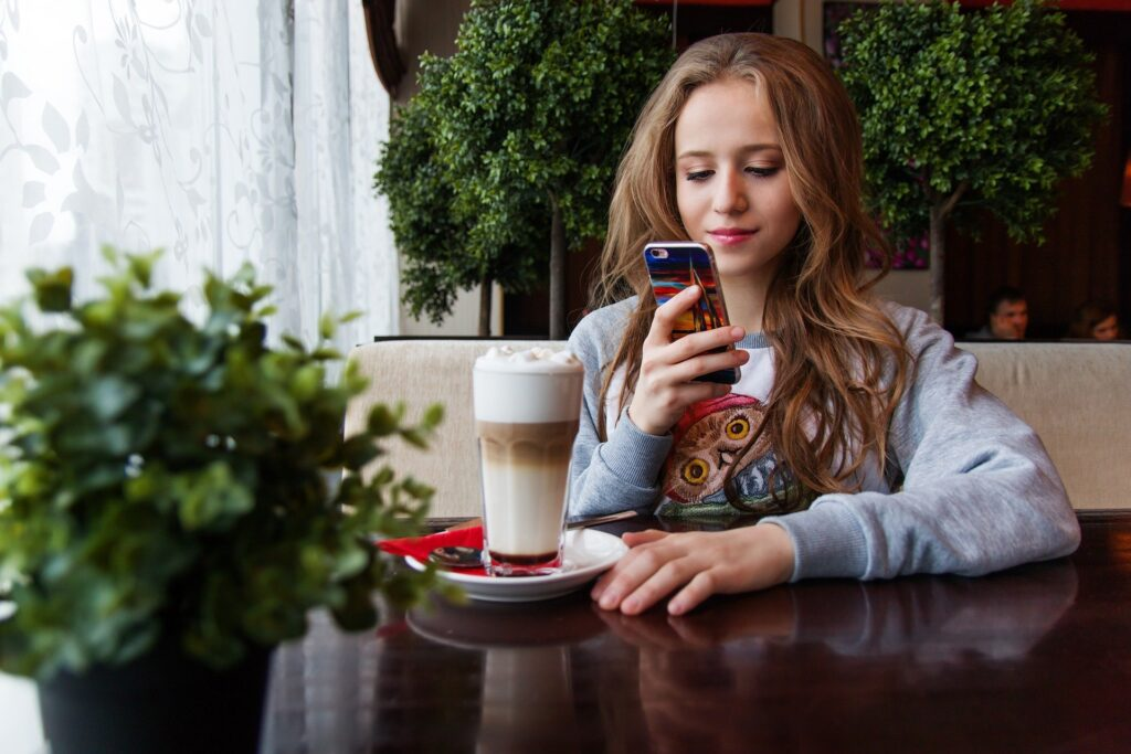 A teenager in a coffee shop