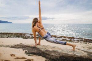 Practising yoga on a beach