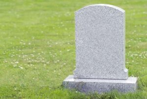 A tombstone in a cemetry