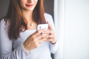 A woman using her mobile phone