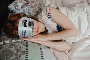A woman wearing a sleep mask