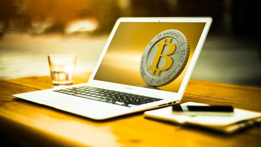 A Bitcoin symbol on a laptop screen