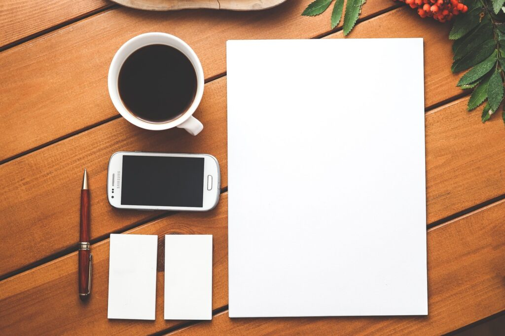 A blank piece of paper and a cup of coffee