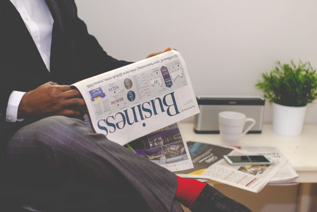 A businessman reading a business newspaper