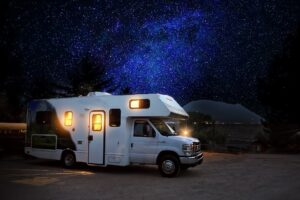 A motorhome parked at night