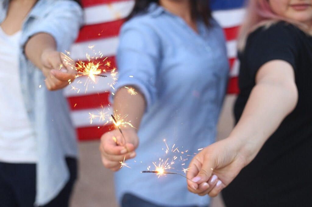Three people playing with sparklers