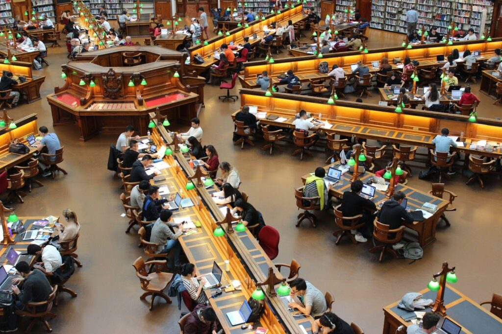 Students studying in a large library