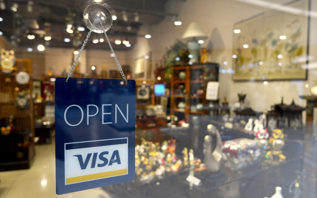 A Visa sign on a shop window