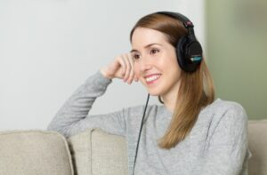 A woman enjoying wearing headphones