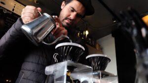 A Barista making coffee