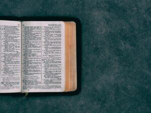An open bible on a desk