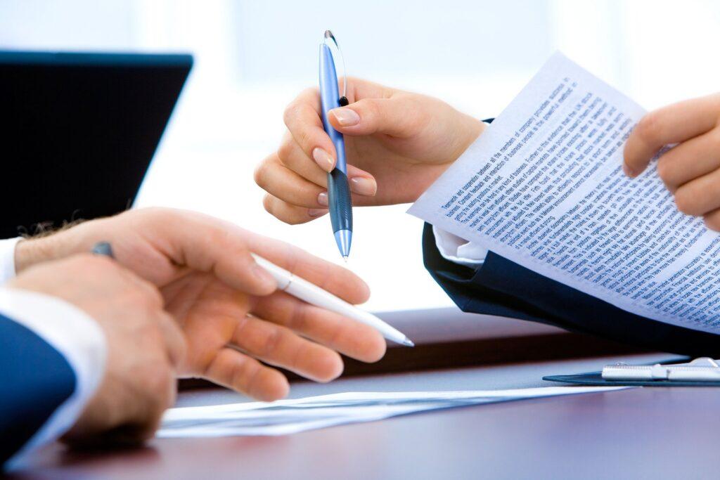 Businessmen signing a deal