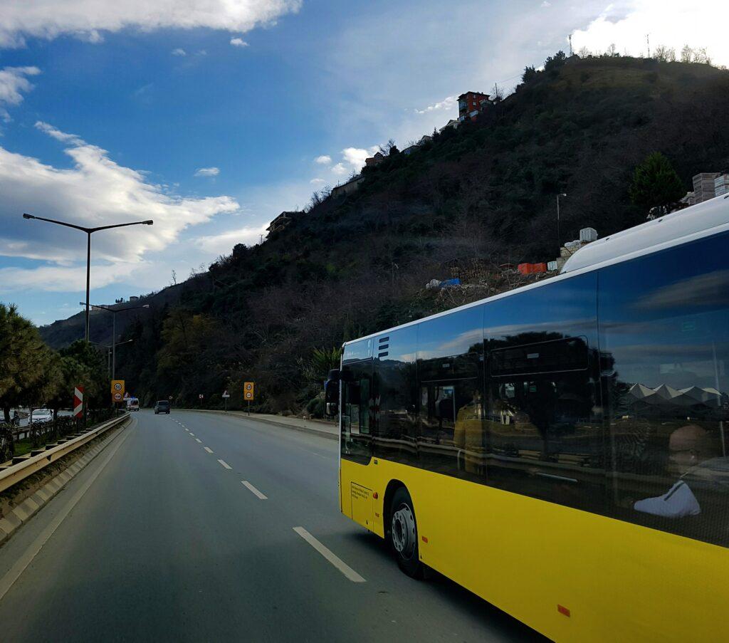 A coach driving along a road