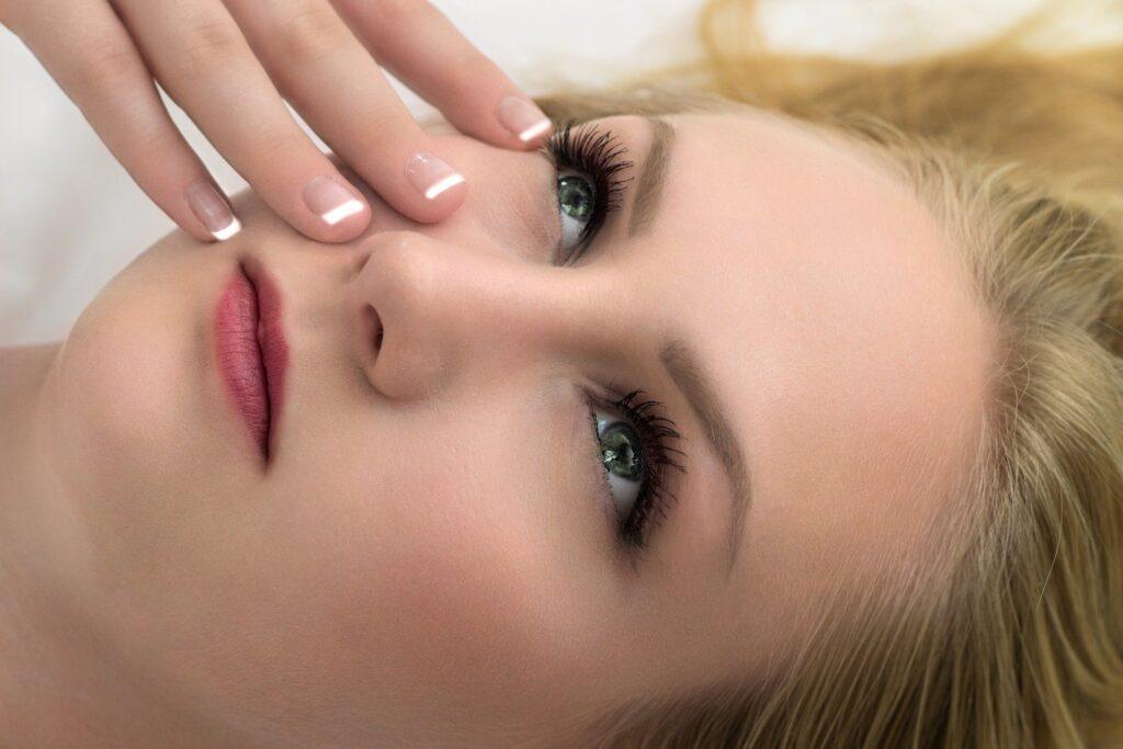 A woman enjoying wearing cosmetics