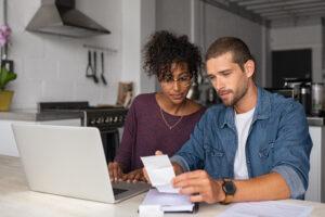 Young couple examining their home finances