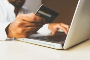 Using a credit card and a laptop